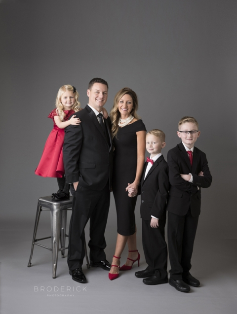 formal family pose in studio